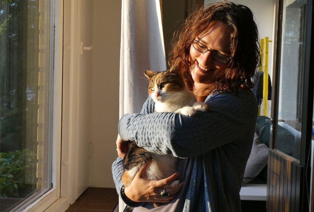 Me cuddling Lucy cat in Finland